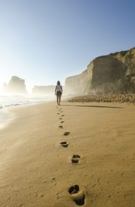 Girl walking on a beach