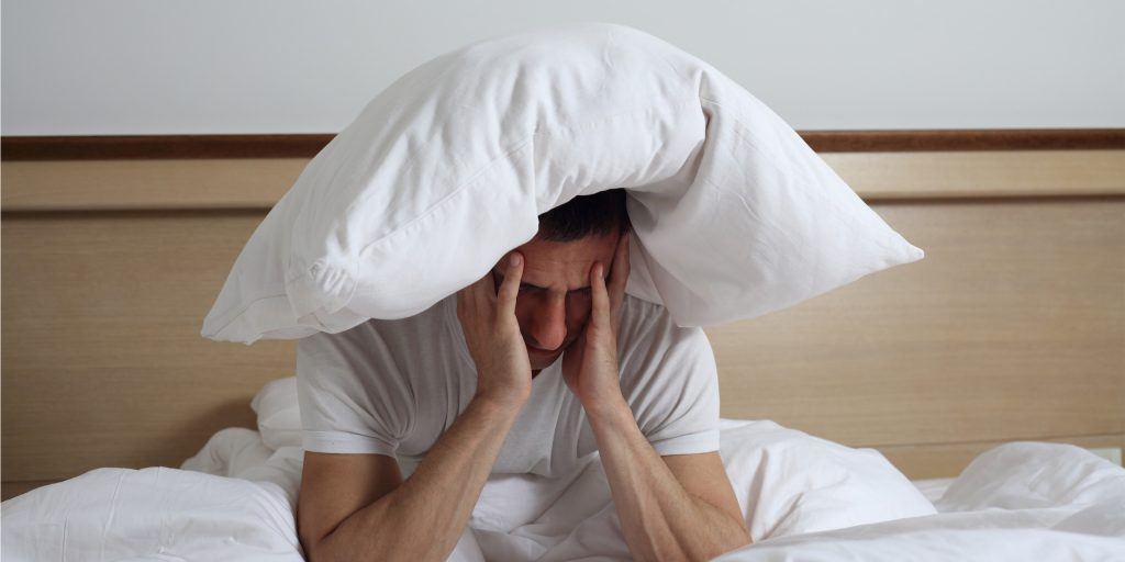 Sleep Disorders and Problems. Man struggling with insomnia.