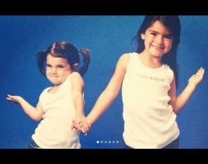 Charli Damelio during her childhood with her elder sister, Dixie Damelio