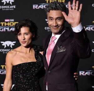 Chelsea Winstanley with her husband, Taika Waititi during an event