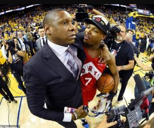 Masai Ujiri celebrating with his team with credentials in his hand