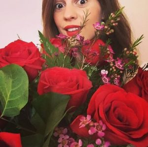 Melanie received a bunch of flowers from her family on her birthday