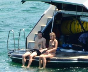 Michael Clarke pictured with Sasha Armstrong in a yacht in Syndney