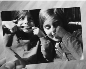 Monica in her childhood with her sister, Eva.