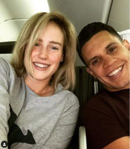 Matt Toomua and her wife Ellyse Perry travelling on the plane