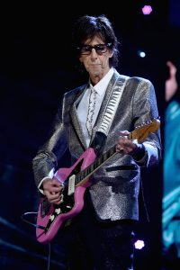 Ric Ocasek playing for the band and the crowd