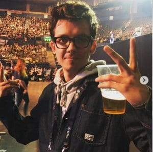 Asa Butterfield while enjoying a beer