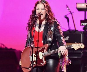 Ashley McBryde while singing in a concert