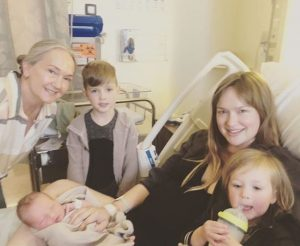 Kaylee DeFer with her mother and three children