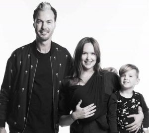 Kaylee DeFer with her spouse and first two children