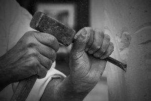hand of stonemason at work