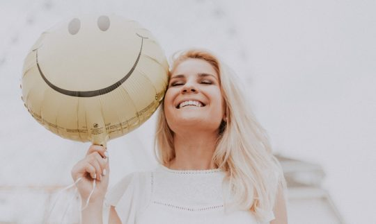 woman smiling with balloon