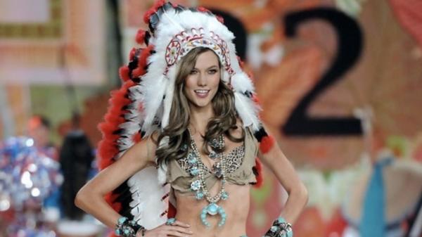 model wearing native american headress