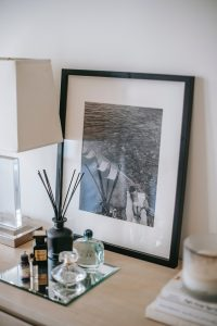 Photo near decorative bottles on table in room