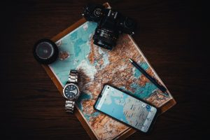 Smartphone Beside Watch and Camera