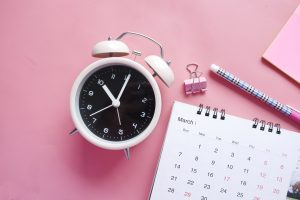 pink background with clock and calender