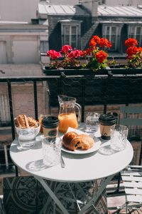 a table with bread and pitcher of juice