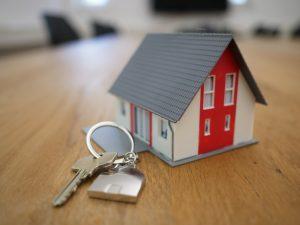 mini model of house and keys